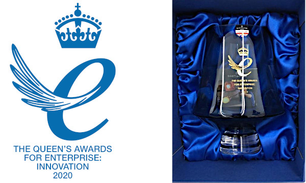 The Queen's Award logo and the accompanying trophy